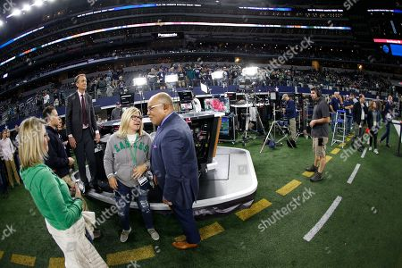 Chris Collinsworth looks on before the Cowboys game against the Philadelphia Eagles in an NFL football game, in Arlington, Texas