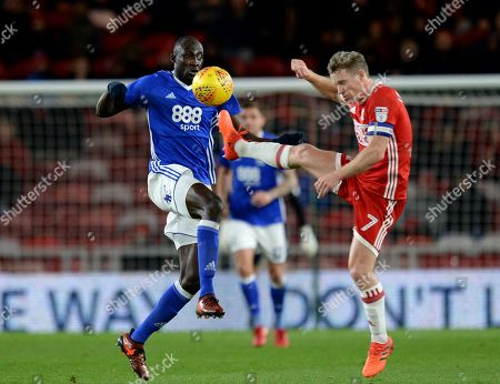Cheikh N?doye of Birmingham City (left) vies for the ball with Grant Leadbitter of Middlesbrough