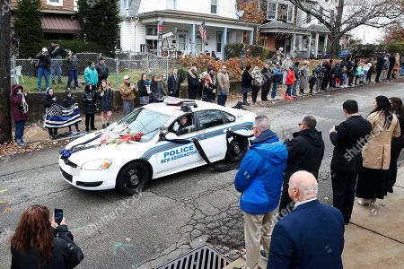 Penn Hills police officer Steffan Shaw, the brother of slain New Kensington Police Officer Brian Shaw, drives his brothers squad car to the funeral at Mount St. Peter Church in New Kensington, Pa., . Shaw was shot and killed during a traffic stop on Friday night