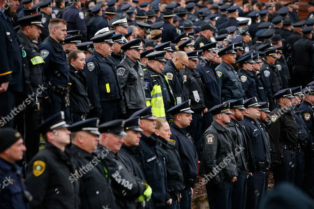 Thousands of police officers attend the funeral for slain New Kensington Police Officer Brian Shaw at Mount St. Peter Church in New Kensington, Pa., . Shaw was shot and killed during a traffic stop on Friday night