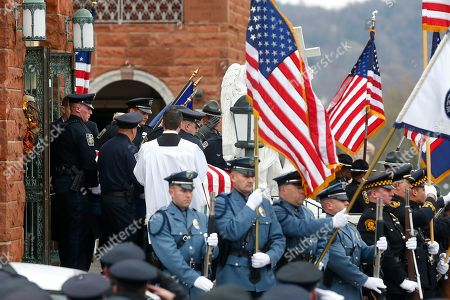 The casket of slain New Kensington Police Officer Brian Shaw is carried out of Mount St. Peter Church following the funeral in New Kensington, Pa., . Shaw was shot and killed during a traffic stop on Friday night
