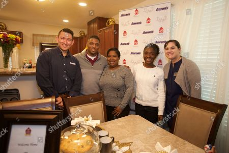 Chris Siebenaler, Warrick Dunn, India Williams, India Williams daughter and Heather Calhoun seen at the Aaron's, Inc. and Warrick Dunn Charities Homes For The Holidays Presentation at India Williams' new home on in Tallahassee, Fla