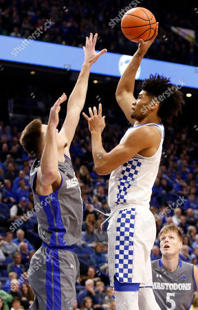 Nick Richards, Dylan Carl. Kentucky's Nick Richards, right, shoots while defended by Fort Wayne's Dylan Carl during the first half of an NCAA college basketball game, in Lexington, Ky