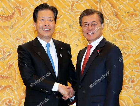Moon Jae-in and with Natsuo Yamaguchi