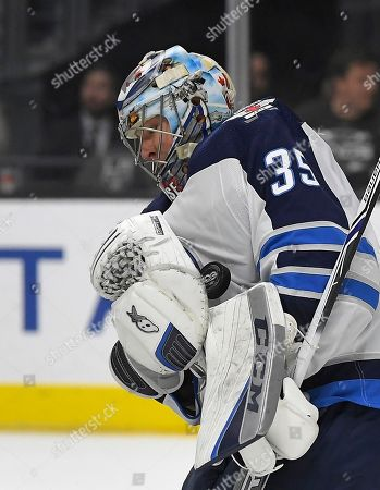 Winnipeg Jets goalie Steve Mason stops a shot during the second period of an NHL hockey game against the Los Angeles Kings, in Los Angeles