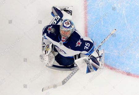 Winnipeg Jets goalie Steve Mason watches the puck fly above him during the third period of an NHL hockey game against the Los Angeles Kings, in Los Angeles. The Jets won 2-1