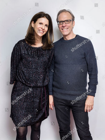 """Amy Ziering, left, and Kirby Dick pose for a portrait to promote the film, """"The Hunting Ground"""", at the Eddie Bauer Adventure House during the Sundance Film Festival, in Park City, Utah"""