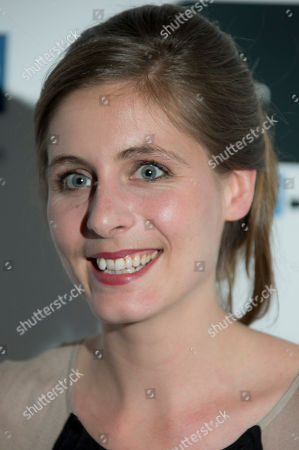 New Zealand author Eleanor Catton, who wrote her prize winning book, The Luminaries, poses for photographs with the Man Booker Prize for Fiction award at Londonâ?™s Guildhall