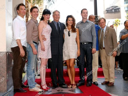 Castmates, from left, Michael Weatherly, Brian Dietzen, Pauley Perrette, Mark Harmon, Cote de Pablo, Sean Murray, Rocky Caroll and David McCallum attend a ceremony awarding Harmon with a star on the Hollywood Walk of Fame, in Los Angeles