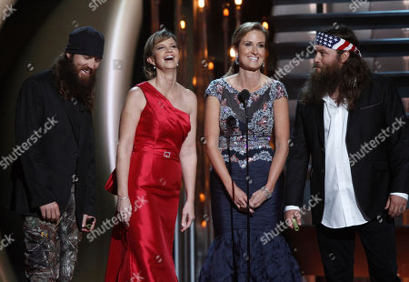 Stock Photo of Duck Dynasty members, from left, Jase Robertson, Missy Robertson, Korie Robertson and Willie Robertson speak onstage at the 47th annual CMA Awards at Bridgestone Arena, in Nashville, Tenn