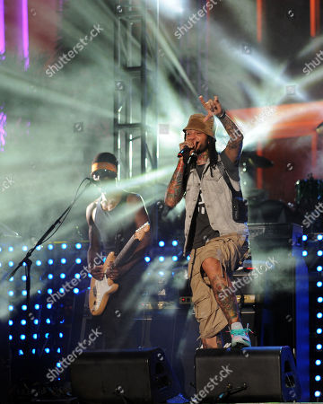 Stock Picture of JUNE 30: Disashi Lumumba-Kasongo and Travie McCoy of Gym Class Heroes perform at the IHeartRadio concert at Fontainebleau Miami Beach on in Miami Beach, Florida