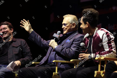 """Moderator Doug Benson, left, Lee Majors, center, and Ray Santiago are seen onstage during a panel for the STARZ Original Series """"Ash vs. Evil Dead"""" at New York Comic Con on in New York"""