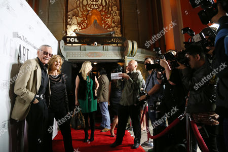 "Stan Lee, founder, chairman, board of director and CCO, POW! Entertainment, left, and comedian Carol Leifer arrive at ""The Hollywood Reporter's Key Art Awards"" Powered by Clio, in Los Angeles"