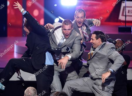 Stock Picture of CORRECTS IDS: NFL player Rob Gronkowski, of the New England Patriots, from second left, accepts the best comeback athlete award with his brothers, NFL free agent Chris Gronkowski and former NFL player Dan Gronkowski at the ESPY Awards at the Microsoft Theater, in Los Angeles