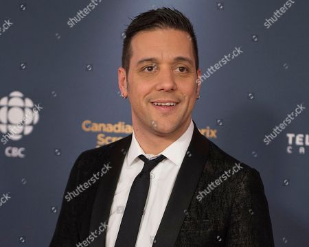 George Stroumboulopoulos poses on the red carpet at the 2014 Canadian Screen Awards, in Toronto.Los Angeles police are searching for a suspect in the killing of a man at a home in the Hollywood Hills. The house is being rented by a former Canadian TV talk-show host Stroumboulopoulos, who says the victim was a close friend who was staying there while he was in New York. Stroumboulopoulos said in a statement Friday afternoon, Sept. 23, 2016, that it appears the killing occurred during a break-in, and he is quickly returning to Los Angeles