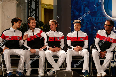 French players Pierre-Hugues Herbert, left, Richard Gasquet, second left, Lucas Pouille, third left, Jo-Wilfried Tsonga and coach Yannick Noah, right, attend the draw for the Davis Cup final in Lille, northern France, . France will face Belgium in the Davis Cup final starting Friday