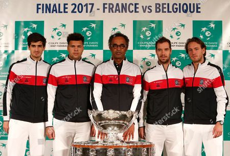 French captian Yannick Noah, center, and players Pierre-Hugues Herbert, left, Jo-Wilfried Tsonga, Richard Gasquet, second right, and Lucas Pouille pose with the trophy during the draw for the Davis Cup final in Lille, northern France, . France will face Belgium in the Davis Cup final starting Friday