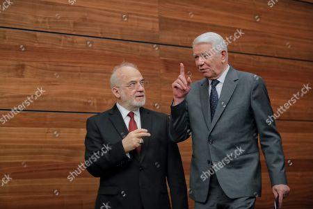 Iraq's Minister for Foreign Affairs Ibrahim Abdulkarim Al-Jafari, left, speaks to Romanian counterpart Teodor Melescanu after joint press statements in Bucharest, Romania