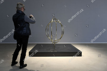 A visitor looks at a sculpture entitled 'Umschlungen in unendlicher Liebe' ('Enlaced in endless love') by German artist Rebecca Horn is on display at the Lehmbruck Museum in Duisburg, Germany, 23 November 2017. The exhibition 'Hauchkoerper als Lebenszyklus' ('Breath body as life cycle') presents the artist's new, large-scale sculptures and runs from 24 November 2017 to 2 April 2018.