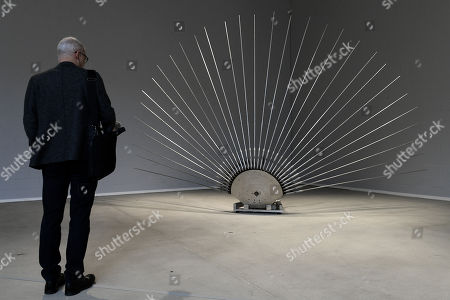 Stock Image of A visitor looks at a sculpture by German artist Rebecca Horn at the Lehmbruck Museum in Duisburg, Germany, 23 November 2017. The exhibition 'Hauchkoerper als Lebenszyklus' (lit. 'Breath body as life cycle') presents the artist's new, large-scale sculptures and runs from 24 November 2017 to 2 April 2018.