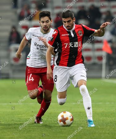 Pierre Lees-Melou of OGC Nice (R) vies for the ball with Sandy Walsh of Zulte Waregem (L) during the UEFA Europa League Group K soccer match between OGC Nice and Zulte Waregem, at the Allianz Riviera stadium, in Nice, France, 23 November 2017.