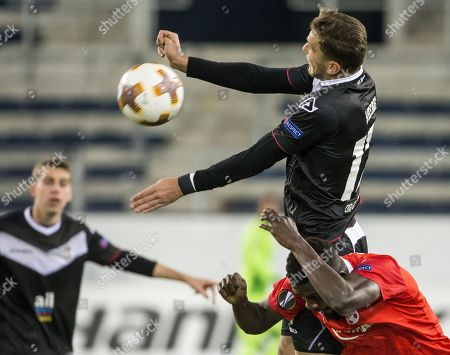Luganos Balint Vecsei (L) fights for the ball with Hapoel's John Ogu (R) during the UEFA Europa League Group G round five match between FC Lugano of Switzerland and Hapoel Beer-Sheva of Israel, at the swisspor Stadion in Lucerne, Switzerland, 23 November 2017.