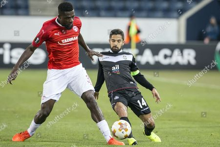 Hapoel's John Ogu (L) fights for the ball with Lugano's Jonathan Sabbatini (R) during the UEFA Europa League Group G soccer match between FC Lugano and Hapoel Beer-Sheva in Lucerne, Switzerland, 23 November 2017.