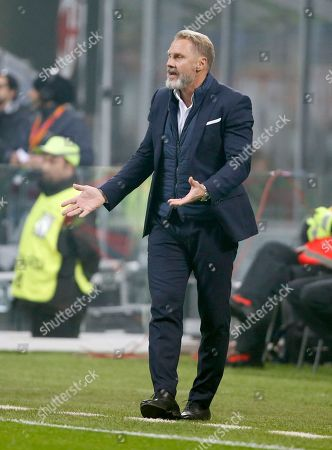 Vienna's head coach Thorsten Fink gives directions to his players during the Europa League group D soccer match between AC Milan and Austria Wien, at the San Siro stadium in Milan, Italy