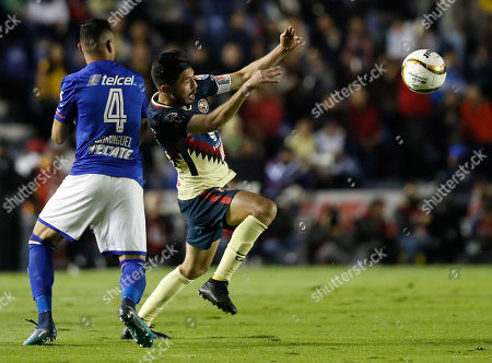 Stock Image of Cruz Azul's Julio Cesar Dominguez, left, fights for the ball with America's Oribe Peralta during a Mexico soccer league match, in Mexico City