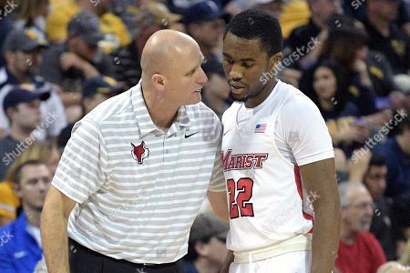 Mike Maker, Austin Williams. Marist head coach Mike Maker, left, gives instructions to guard Austin Williams (22) during the first half of an NCAA college basketball game against West Virginia at the AdvoCare Invitational tournament, in Lake Buena Vista, Fla
