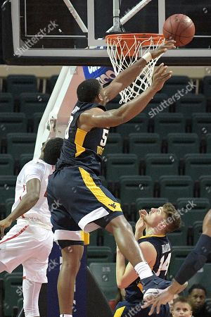 Chase Harler, Sagaba Konate, Austin Williams. West Virginia forward Sagaba Konate (50), center, blocks a shot by Marist guard Austin Williams, left, as West Virginia's guard Chase Harler (14) watches during the second half of an NCAA college basketball game at the AdvoCare Invitational tournament, in Lake Buena Vista, Fla