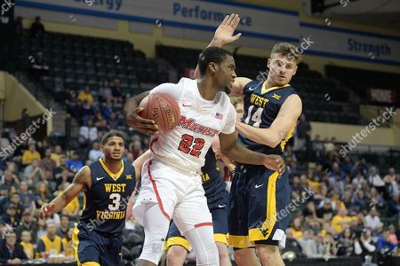 Austin Williams, James Bolden, Chase Harler. Marist guard Austin Williams (22) grabs a rebound in front of West Virginia guard James Bolden (3) and guard Chase Harler (14) during the first half of an NCAA college basketball game at the AdvoCare Invitational tournament, in Lake Buena Vista, Fla