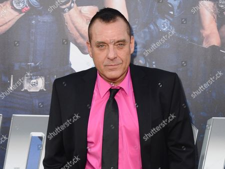 """Actor Tom Sizemore arrives at the premiere of """"The Expendables 3"""" in Los Angeles. Los Angeles prosecutors say Sizemore has been charged with three misdemeanors in connection with his arrest in a domestic violence case. The city's attorney's office says the actor was charged this week with intimate partner abuse, intimate partner battery and making terrorist threats"""