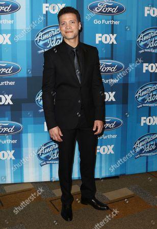"Justin Guarini arrives at the ""American Idol"" farewell season finale in Los Angeles. Guarini stars in the a capella Broadway musical â?oeIn Transit.â"
