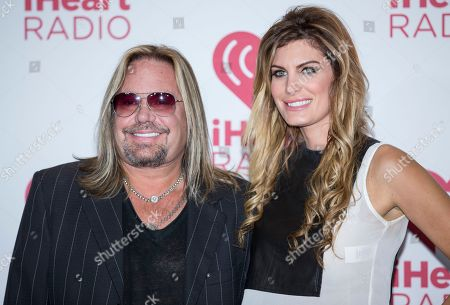 Vince Neil and girlfriend Rain Andreani arrive at the iHeart Radio Music Festival, at The MGM Grand Garden Arena in Las Vegas. The rock n' roller Neil is taking a fight over his Internet personna to state court in Las Vegas with a lawsuit accusing an Oregon social media consultant of refusing to give up control of his Facebook and LinkedIn accounts. The consultant, Kristy Sinsara, said, the civil lawsuit stems from a gross misunderstanding