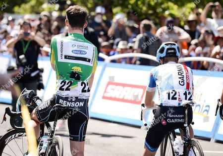 Stock Photo of In support of Amgen's Breakaway from Cancer initiative, Amgen Tour of California professional cyclists Mark Cavendish, left, and Tom Danielson honor a loved one during a moment of silence as part of the Breakaway Moment Tribute at the race start on in San Jose, Calif. All cyclists wore a commemorative number honoring someone in their life impacted by cancer