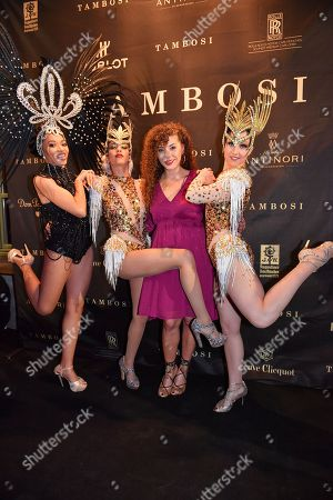 Stock Photo of Edita Abdieski with Samba dancers