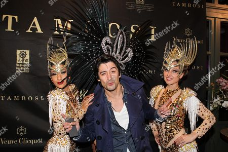 Stock Picture of Adrian Can with Samba dancers