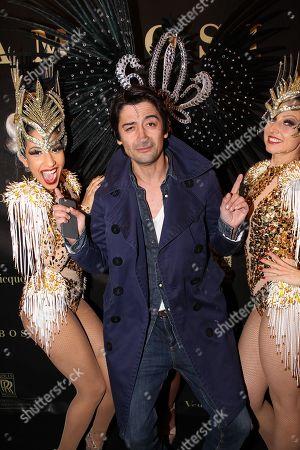 Adrian Can with Samba dancers