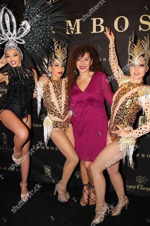 Edita Abdieski with Samba dancers