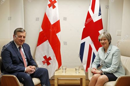Britain's Prime Minister Theresa May (R) and Georgia's Prime Minister Giorgi Kvirikashvili (L) attend a bilateral meeting during the EU Eastern Partnership (EaP) Summit in Brussels, Belgium, 24 November 2017. The summit brings together EU heads of states or government with six former Soviet states Armenia, Azerbaijan, Belarus, Georgia, Moldova and Ukraine.