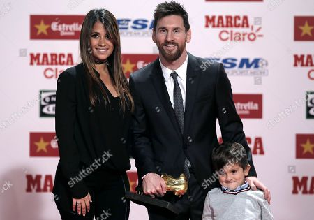Lionel Messi, Antonella Roccuzzo, Thiago. FC Barcelona's Lionel Messi poses with his wife Antonella Roccuzzo and their son Thiago after receiving his Golden boot award for leading all of Europe's leagues in scoring last season in Barcelona, Spain, . Messi scored 37 goals in the Spanish league last season. It was the fourth time the Barcelona forward has received the honor