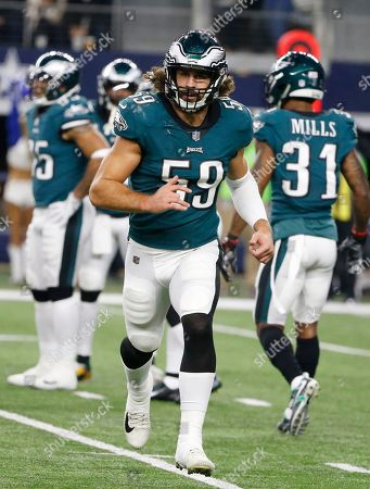 Philadelphia Eagles inside linebacker Joe Walker (59) runs off the field as they played against the Dallas Cowboys during an NFL football game, in Arlington, Texas