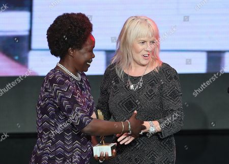 Cherry Alexander of Britain (R) receives from Tegla Loroupe of Kenia (L) the Women in Athletics Award 2017, during the IAAF Athletes of the Year Award Ceremony in Monaco, 24 November 2017.