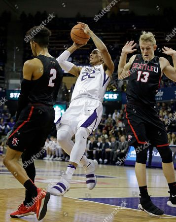 Stock Image of Jordan Hill, Josh Hearlihy. Washington's Dominic Green (22) tries to get off a pass between Seattle's Jordan Hill (2) and Josh Hearlihy (13) in the first half of an NCAA college basketball game, in Seattle