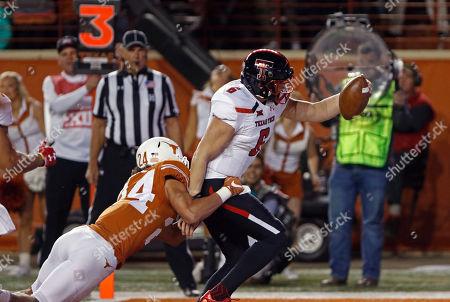 Stock Picture of McLane Carter, John Bonney. Texas Tech quarterback McLane Carter (6) runs for a touchdown against Texas defender John Bonney (24) during the first half of an NCAA college football game, in Austin, Texas