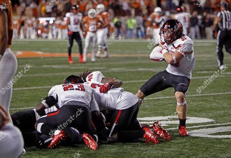 Texas Tech defensive back Justus Parker (31) celebrates teammate Douglas Coleman III's interception of Texas quarterback Sam Ehlinger's pass during the second half of an NCAA college football game, in Austin, Texas. Texas Tech won 27-23