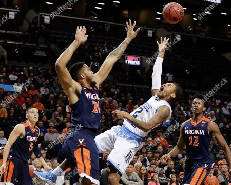 Rhode Island's Fatts Russell (2) shoots over Virginia's Isaiah Wilkins (21) as De'Andre Hunter (12) watches during the first half of an NCAA college basketball game in the championship round of the NIT Season Tip-Off tournament, in New York
