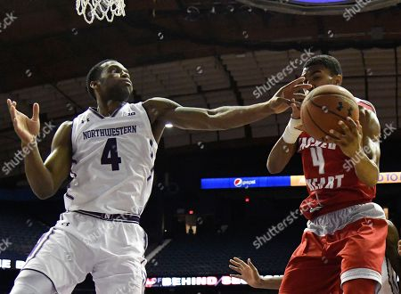 Vic Law, Alex Watson. Northwestern forward Vic Law, left, and Sacred Heart guard Alex Watson, right, go for the ball during the second half of an NCAA college basketball game, in Rosemont, Ill. Northwestern won 81-50