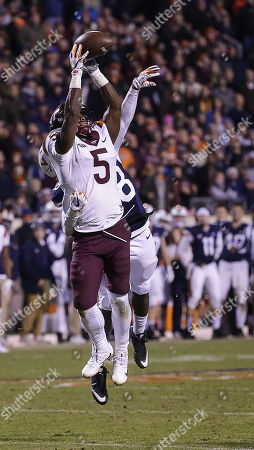 Virginia Tech Hokies WR #5 Cam Phillips is unable the make a catch with University of Virginia Cavalier FS #28 Brenton Nelson guarding him during NCAA football game between the University of Virginia Cavaliers and the Virginia Tech Hokies at Scott Stadium in Charlottesville, Virginia